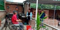 武乡县故城镇残联回访2018年贫困残疾人家庭无障碍改造户 - 残疾人联合会